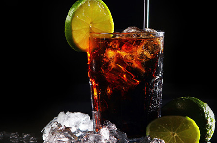 Fresh cola drink with ice and green lime on black background; Shutterstock ID 71967433; PO: The Huffington Post; Job: The Huffington Post; Client: The Huffington Post; Other: The Huffington Post